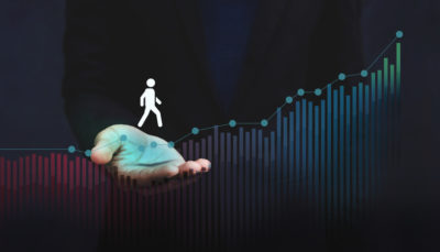 An icon of a person walking along a bar graph, symbolic of the members journey.